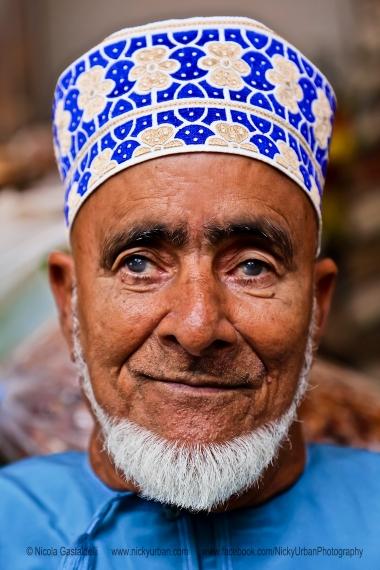 Oman. Muscat. A man selling fish at the market.