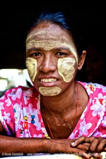 Myanmar. Yangon. A lady wearing Thanaka.