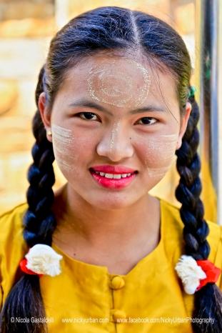 Myanmar. Inle Lake. A lady wearing Thanaka.