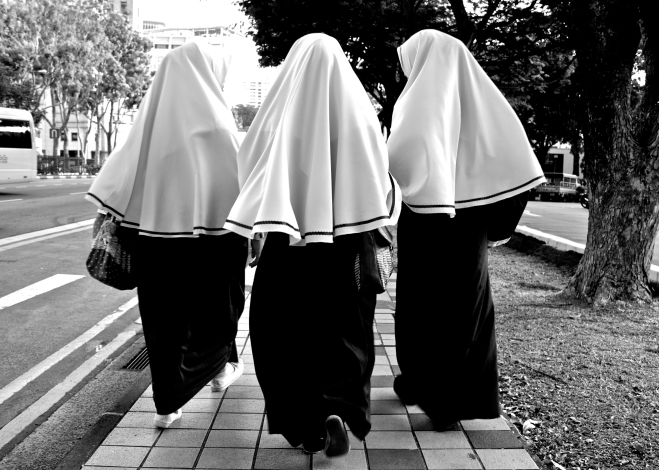 Singapore. Madrasah student back from school.