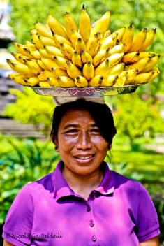 Indonesia. Bali. A woman selling bananas.